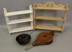 A late Victorian set of white painted three tier wall hanging shelves,