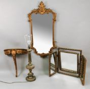A reproduction mid 18th century style gilt frame wall mirror, of shaped outline,