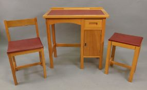 A child's Taylor light wood desk, 69cm wide x 38cm deep x 69cm high with matching chair and stool,