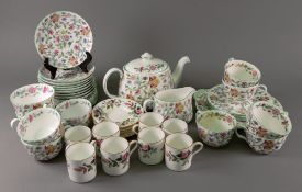 A Minton Haddon Hall thirty-one piece tea service and eight Wedgwood Hathaway Rose coffee cans and