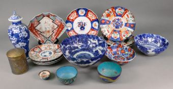 A collection of eight Hizen Imari plates and dishes and a similar bowl,