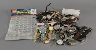 A large collection of modern wrist watches and batteries (qty).