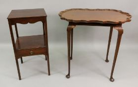 A 'Chippendale Revival' mahogany centre table, with shaped oval tray top, on slender cabriole legs,