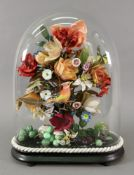 A pastiche of a Victorian flower arrangement, 20th century, with a bird and fruits,