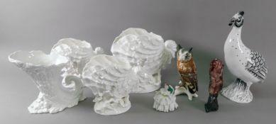 A set of three white glazed nautilus she