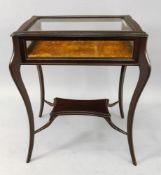 An Edwardian mahogany curio table, with