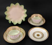 A pair of English tea bowls and saucers