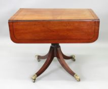 A Regency mahogany ebony strung breakfast table, with hinged drop leaves, end drawer,