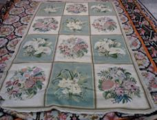 A Portuguese chain stitch needlework carpet with three x four panels in alternating green and ivory,