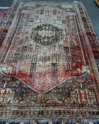 A Ghasghai Persepolis carpet, South Persian, the madder field with a brown medallion,