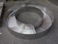A 20th century circular low chrome tree guard, 126cm diameter and another similar smaller,