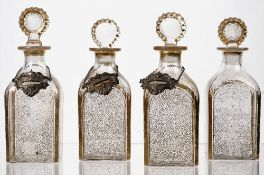 Four square glass decanters and stoppers, 19th century, each with gilt vermicule decoration,