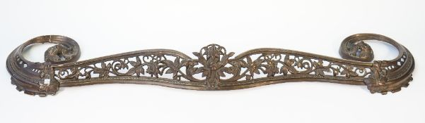 A patinated steel fire kerb, late 19th century, with a pierced foliate cast frieze and scroll ends,