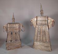 A similar pair of Middle Eastern embossed metal vessels,