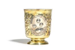 An 18th century Russian parcel gilt beaker, the body with three oval reserves, having Latin mottos,
