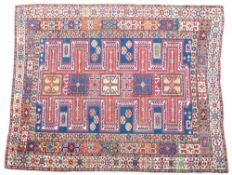 A Shirran rug, Caucasion, the indigo field with five connected crosses, a hooked motif,
