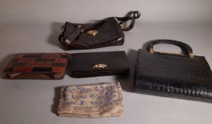 A group of four 20th century leather handbags and a beadwork clutch bag, (5).
