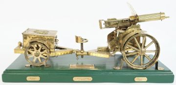 A brass model of a WW I Vickers machine gun with a carriage and limber, 20th century,