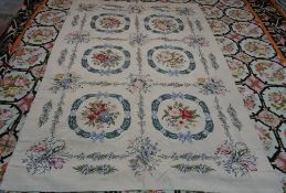 A modern tapestry needlework, the fawn field with six panels,