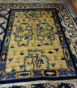A Peking Chinese carpet, the ivory field with four cartouche,