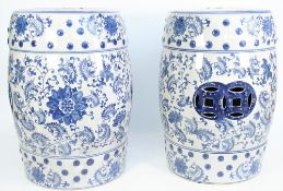 A pair of modern Chinese style blue and white pottery garden seats decorated with stylised flowers,
