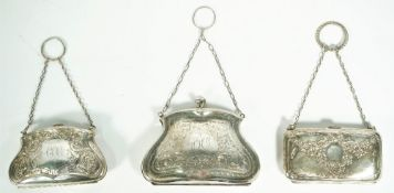 Three lady's silver purses, each having engraved decoration,