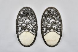 Raymond Subes attributed, a pair of French wrought iron and marble mounted wall lights,