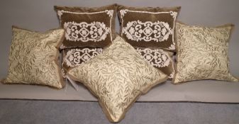 A group of seven 20th century scatter cushions, to include a set of four and three others,