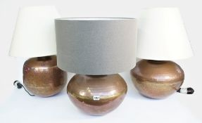 A pair of modern copper table lamps,