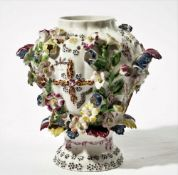 A Bow frill vase, circa 1765, with female mask and foliage handles,