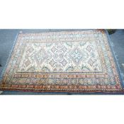A Shirvan rug, caucasian, the ivory field with two diamonds, other motifs,