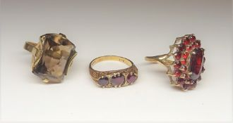 A 9ct gold and garnet set marquise shaped cluster ring,