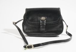 A Gucci style black leather lady's handbag with gilt metal hardware and adjustable shoulder strap,