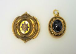 A Victorian gold, black enamelled and banded agate pendant mourning locket,