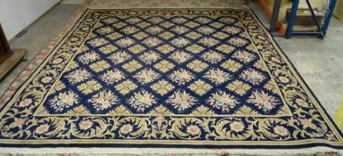A Kashan carpet, Persian, the indigo field with diamond shaped floral leaf motifs,