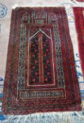 A Beluchistan prayer rug, the mehrab with a flowering tree, three minarets to arch,