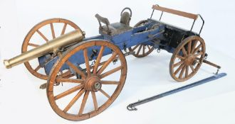 A large bronze model of a field gun with blue painted wooden carriage and limber, mid-20th century,
