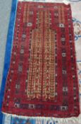 A Beluchistan prayer rug, the camel field with three flowering trees, matching spandrels,