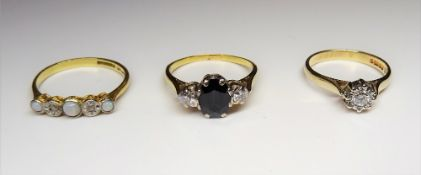 A gold, sapphire and diamond set three stone ring,