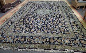 A Kashan carpet, Persian, the indigo field with a pale indigo roundel,