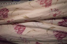 A pair of lined and interlined floral curtains, 150cm wide x 148cm drop.