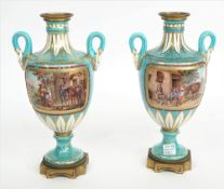 A pair of Sevres-style gilt-metal mounted two-handled vases, 19th century,