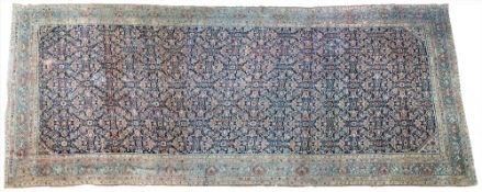 An unusual North West Persian Kelleh carpet, the dark indigo field with an allover herate design,