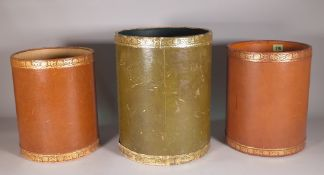 A pair of 20th century tan leather cylindrical waste paper bins,