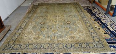 A Tabriz carpet, Persian the pale indigo field with a bold saffron medallion, ivory spandrels,