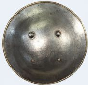 An Iranian steel shield, 18th century, with engraved figural decoration to the centre,