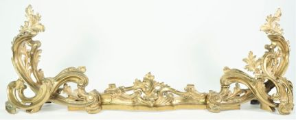 A Louis XV style brass fender of foliate scroll form in three adjustable parts, 108cm wide.