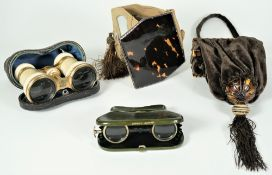 A pair of Victorian brass and ivory bound opera glasses in a velvet lined leather case,
