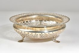 A silver shaped circular bowl, with scroll pierced decoration, within a shaped rim,