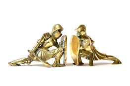 Noel Coulon, French, circa 1930, a pair of Art Deco cubist bronze bookends of knights,